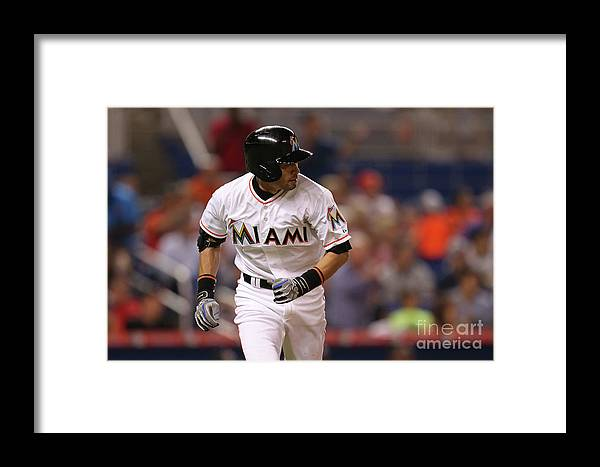 Second Inning Framed Print featuring the photograph Baltimore Orioles V Miami Marlins 1 by Rob Foldy