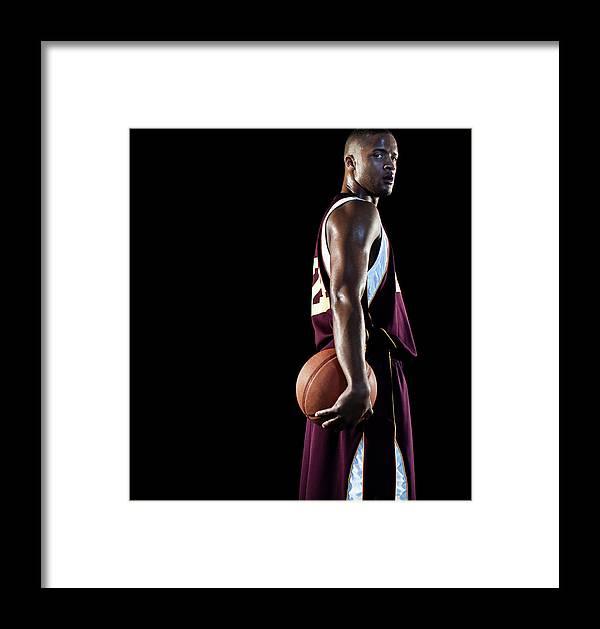 Three Quarter Length Framed Print featuring the photograph Basketball Player by Patrik Giardino