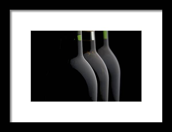 Rose Wine Framed Print featuring the photograph Bottles Of Wine In A Row by Halbergman