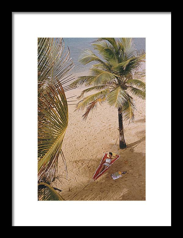 Tranquility Framed Print featuring the photograph Caribe Hilton Beach by Slim Aarons