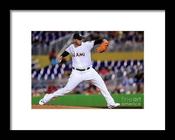People Framed Print featuring the photograph Cincinnati Reds V Miami Marlins by Rob Foldy