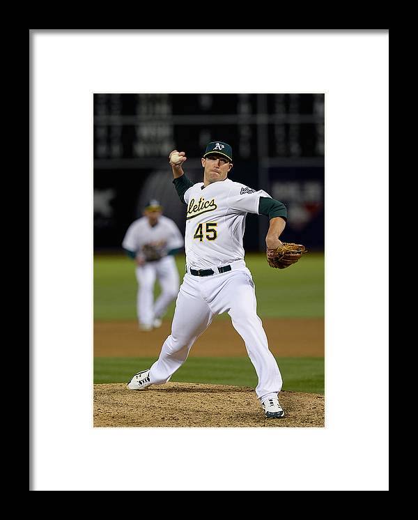Ninth Inning Framed Print featuring the photograph Cleveland Indians V Oakland Athletics - by Thearon W. Henderson