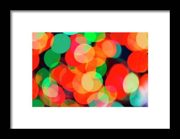 Holiday Framed Print featuring the photograph Defocused Lights by Tetra Images
