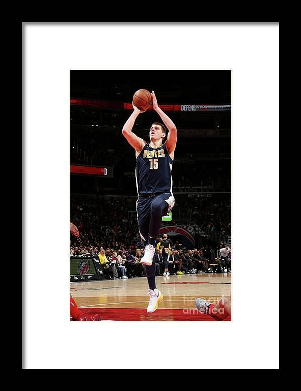 Nba Pro Basketball Framed Print featuring the photograph Denver Nuggets V Washington Wizards by Ned Dishman