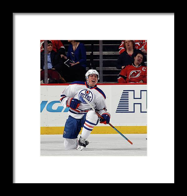 c6cc6eedbc6 People Framed Print featuring the photograph Edmonton Oilers V New Jersey  Devils by Bruce Bennett