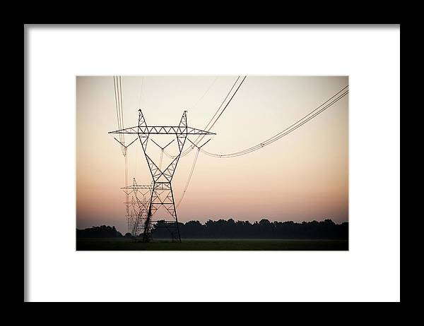Tranquility Framed Print featuring the photograph Electrical Power Lines Against The by Wesley Hitt