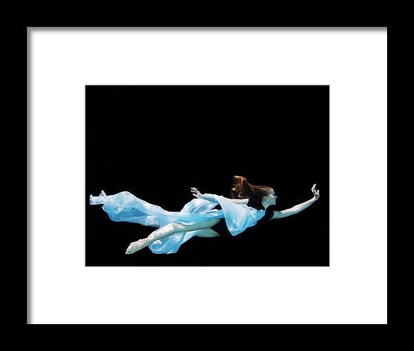 Ballet Dancer Framed Print featuring the photograph Female Dancer Underwater Against Black by Thomas Barwick