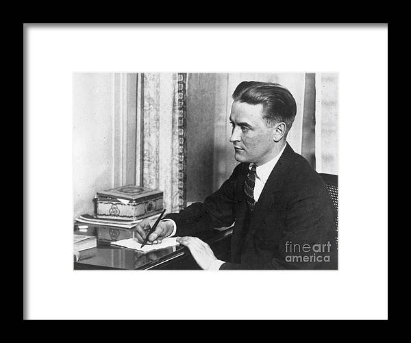 People Framed Print featuring the photograph F.scott Fitzgerald Writing At Desk by Bettmann