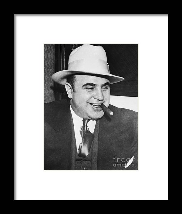 Al Capone Framed Print featuring the photograph Gangster Al Capone Smoking Cigar by Bettmann