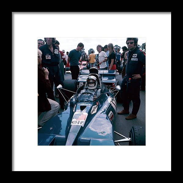 Crash Helmet Framed Print featuring the photograph Jackie Stewart At The Wheel Of A Racing by Heritage Images