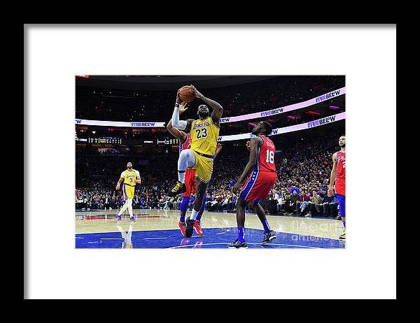 Nba Pro Basketball Framed Print featuring the photograph Kobe Bryant And Lebron James by Jesse D. Garrabrant