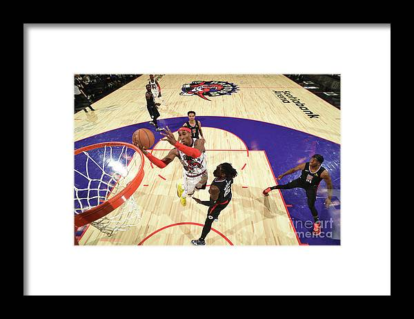 Nba Pro Basketball Framed Print featuring the photograph La Clippers V Toronto Raptors by Ron Turenne
