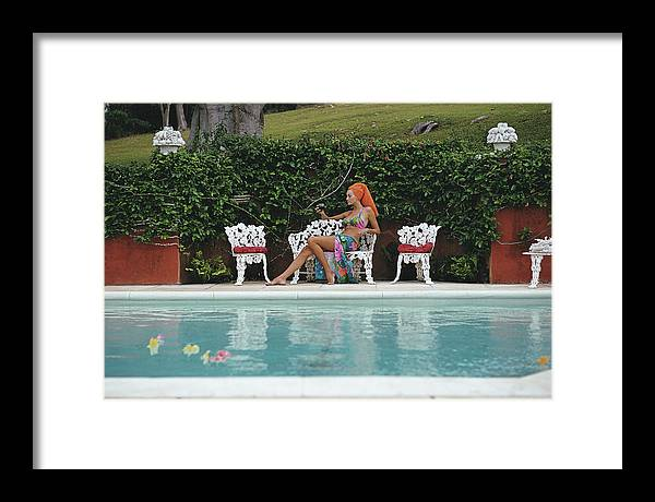 People Framed Print featuring the photograph Lounging In Bermuda by Slim Aarons