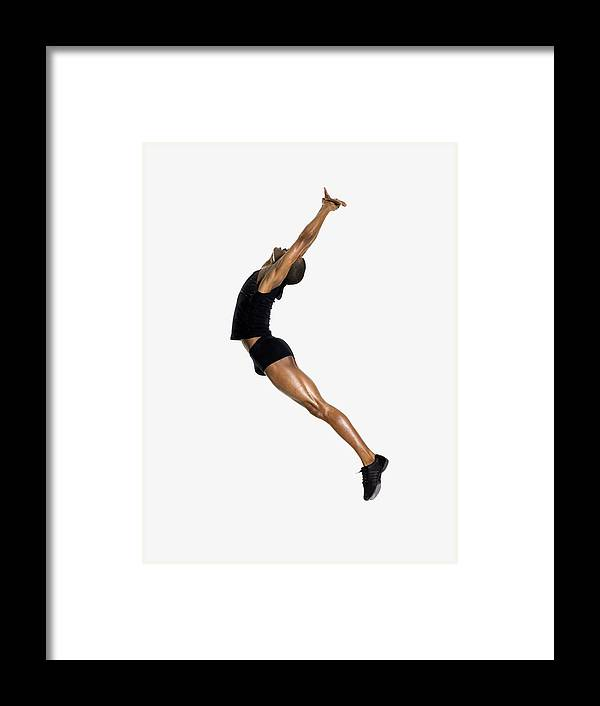Young Men Framed Print featuring the photograph Male Dancer Jumping by Image Source