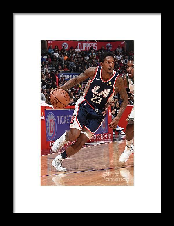 Nba Pro Basketball Framed Print featuring the photograph Milwaukee Bucks V La Clippers by Adam Pantozzi