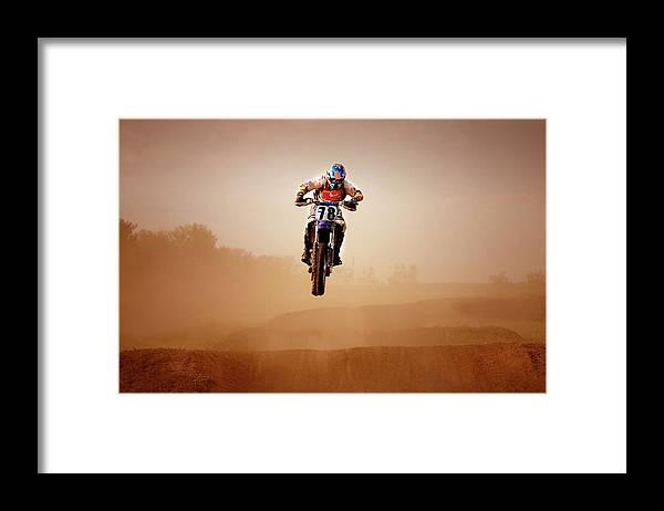 Crash Helmet Framed Print featuring the photograph Motocross Rider by Design Pics