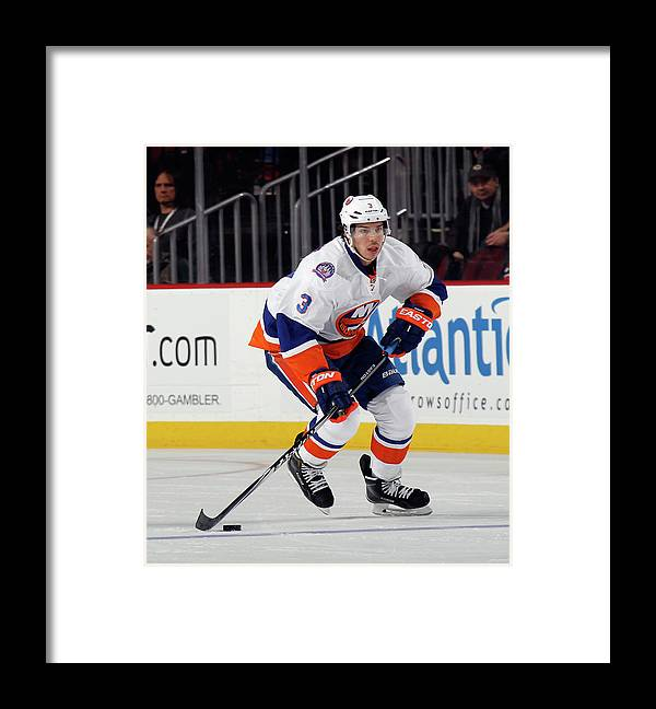 People Framed Print featuring the photograph New York Islanders V New Jersey Devils by Bruce Bennett