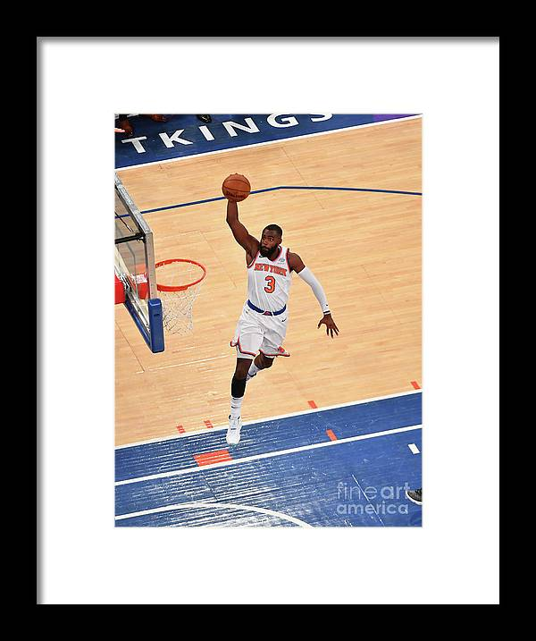 Tim Hardaway Jr. Framed Print featuring the photograph New York Knicks V Cleveland Cavaliers by Jesse D. Garrabrant