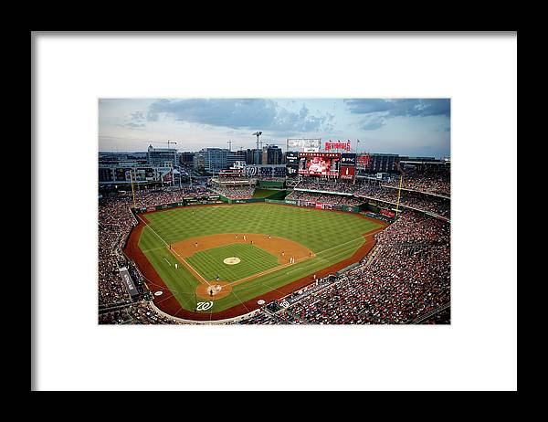 American League Baseball Framed Print featuring the photograph New York Mets V Washington Nationals by Rob Carr