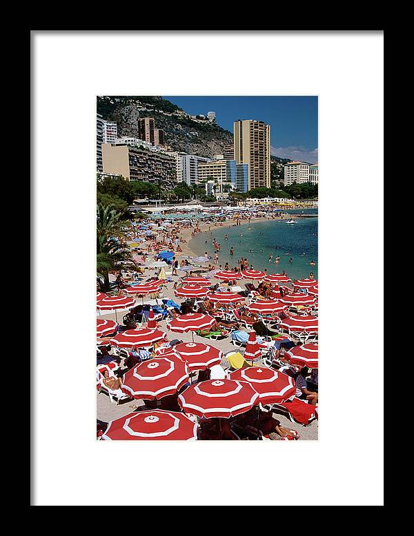 Shadow Framed Print featuring the photograph Overhead Of Red Sun Umbrellas At by Dallas Stribley