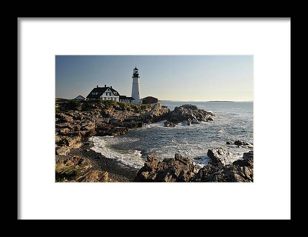 Water's Edge Framed Print featuring the photograph Portland Head Light by Aimintang