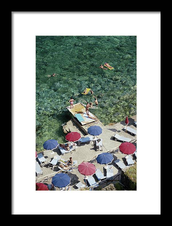 People Framed Print featuring the photograph Porto Ercole Beach by Slim Aarons
