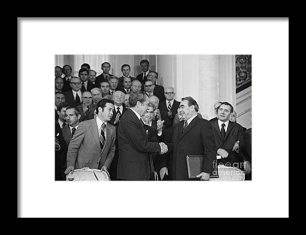 Trading Framed Print featuring the photograph President Richard Nixon And Premier by Bettmann
