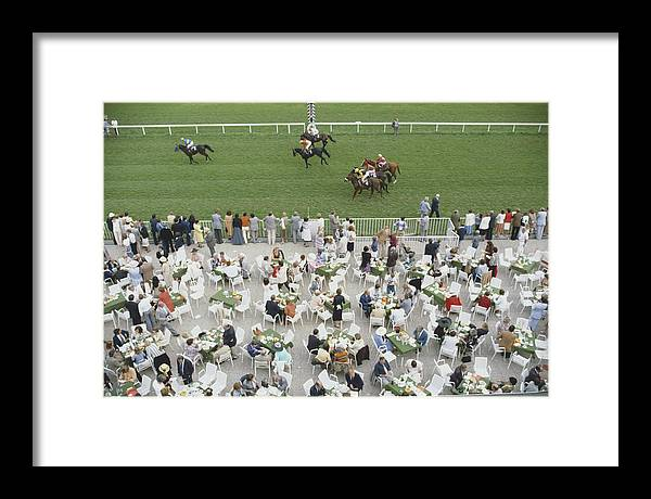 Horse Framed Print featuring the photograph Racing At Baden-baden by Slim Aarons