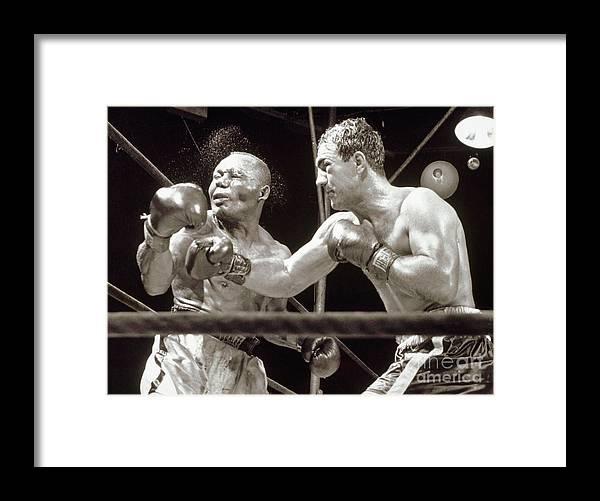 People Framed Print featuring the photograph Rocky Marciano Defeats Jersey Joe by Bettmann