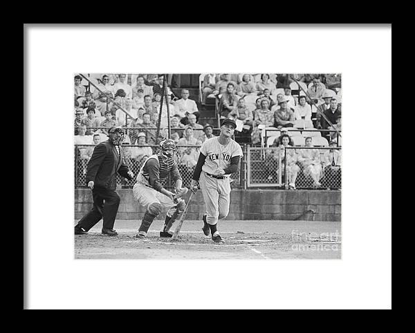 People Framed Print featuring the photograph Roger Maris Hitting Home Run by Bettmann