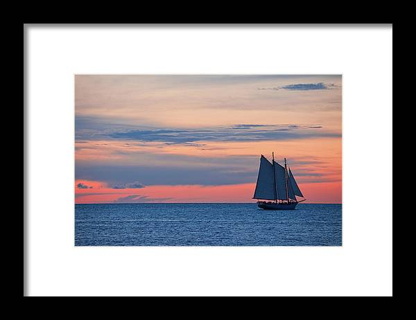 Sailboat Framed Print featuring the photograph Sailboat At Sunset by Thepalmer