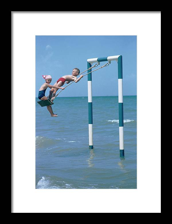 Adriatic Sea Framed Print featuring the photograph Sea Swing by Slim Aarons
