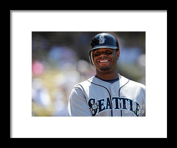 People Framed Print featuring the photograph Seattle Mariners V Los Angeles Dodgers by Lisa Blumenfeld