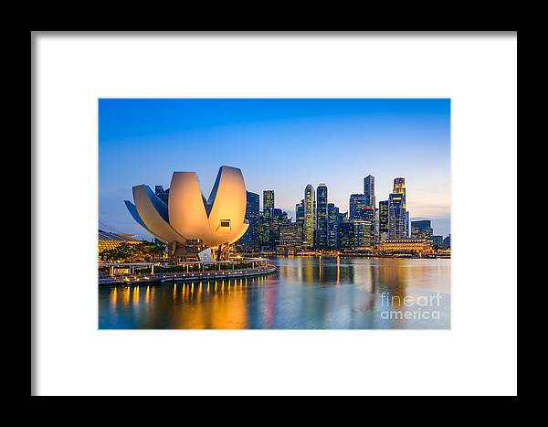 Country Framed Print featuring the photograph Singapore Skyline At The Marina During by Sean Pavone