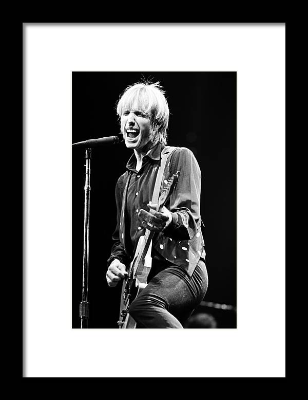 Tom Petty Framed Print featuring the photograph Singer Tom Petty Performs In Concert by George Rose