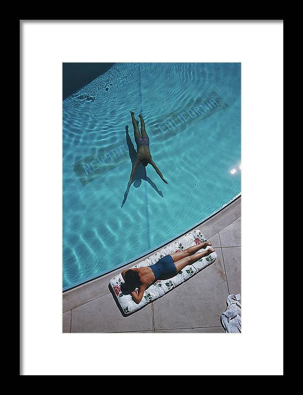 Young Men Framed Print featuring the photograph Swimmer And Sunbather by Slim Aarons