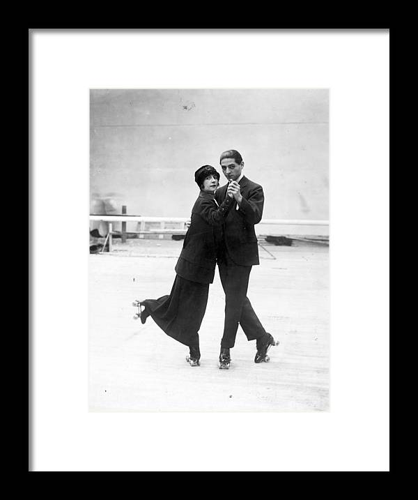 Recreational Pursuit Framed Print featuring the photograph Tango Skating by Topical Press Agency