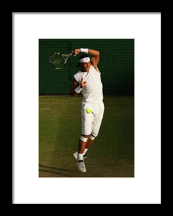 Rafael Nadal Framed Print featuring the photograph The Championships - Wimbledon 2008 Day by Ian Walton