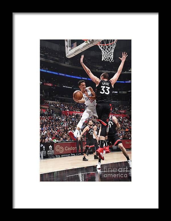 Nba Pro Basketball Framed Print featuring the photograph Toronto Raptors V Los Angeles Clippers by Adam Pantozzi