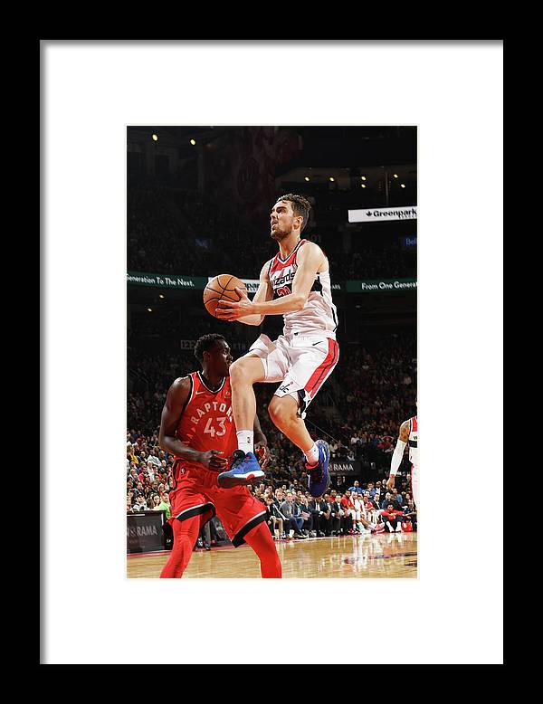 Nba Pro Basketball Framed Print featuring the photograph Washington Wizards V Toronto Raptors by Ron Turenne