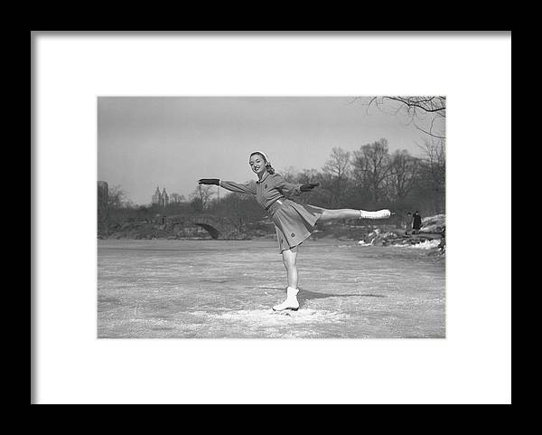 Human Arm Framed Print featuring the photograph Woman Ice Skating Outdoors, B&w by George Marks