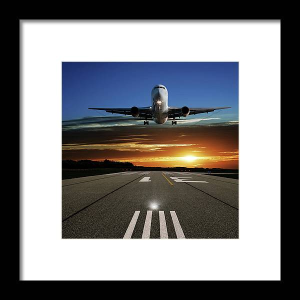 Orange Color Framed Print featuring the photograph Xl Jet Airplane Landing At Sunset by Sharply done