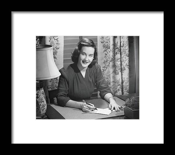 People Framed Print featuring the photograph Young Woman Writing Letter At Desk, B&w by George Marks