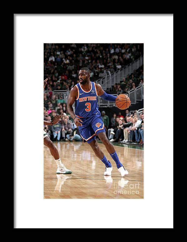 Tim Hardaway Jr. Framed Print featuring the photograph New York Knicks V Milwaukee Bucks by Gary Dineen