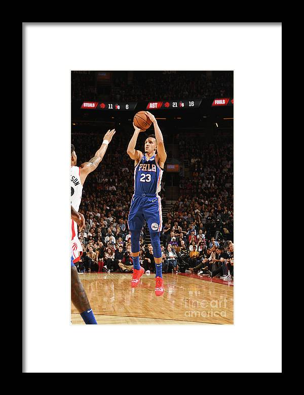 Nba Pro Basketball Framed Print featuring the photograph Philadelphia 76ers V Toronto Raptors by Ron Turenne