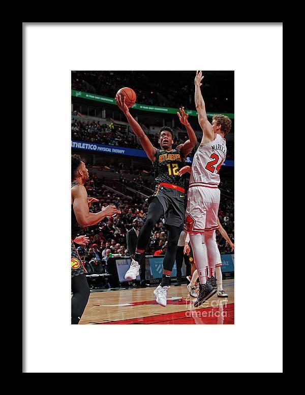 De'andre Hunter Framed Print featuring the photograph Atlanta Hawks V Chicago Bulls by Jeff Haynes