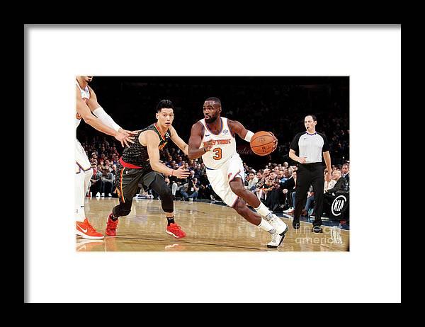 Tim Hardaway Jr. Framed Print featuring the photograph Atlanta Hawks V New York Knicks by Nathaniel S. Butler