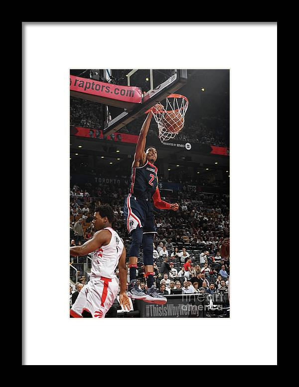 Playoffs Framed Print featuring the photograph Washington Wizards V Toronto Raptors - by Ron Turenne