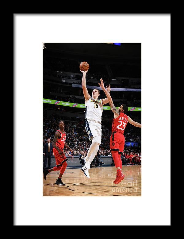 Nba Pro Basketball Framed Print featuring the photograph Toronto Raptors V Denver Nuggets by Garrett Ellwood