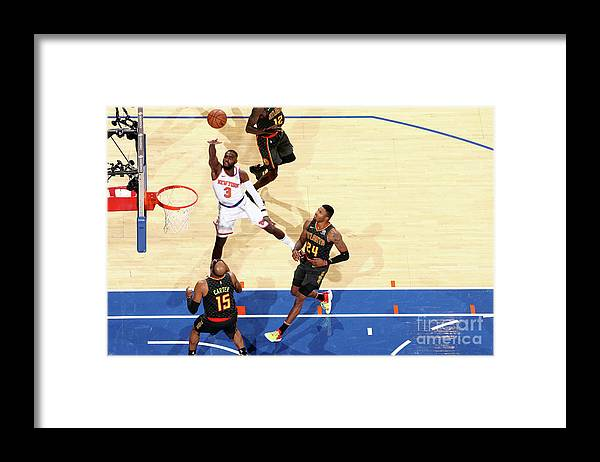 Tim Hardaway Jr. Framed Print featuring the photograph Atlanta Hawks V New York Knicks by Nathaniel S. Butler